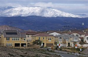 Snow covers the hills north of Santa Clarita, overlooking the Five Knolls development, as seen from Ermine Street at Golden Valley Road on Monday morning. Katharine Lotze/Signal